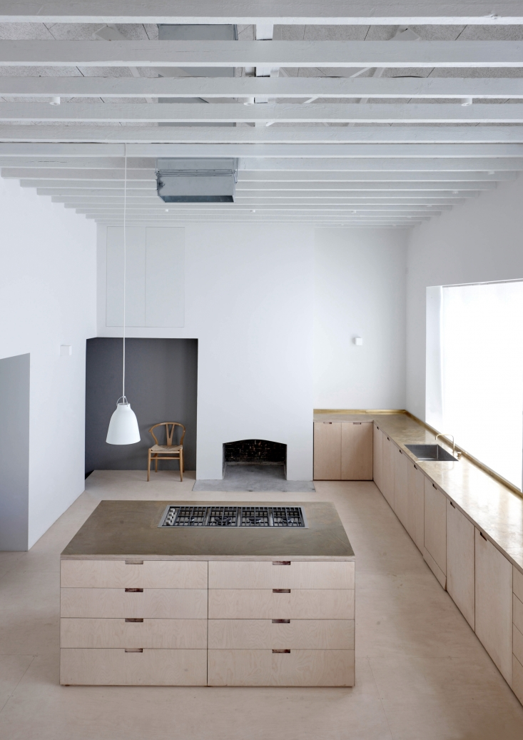 "Viewed from the upstairs bedroom, the kitchen is ""almost church-like in scale and arrangement"" says McLaren, noting that the materials have been ""left in their natural state—'as found'—and, together with the pleasing rhythms of the original building, combine to make a building of conceptual simplicity and spatial purity."""