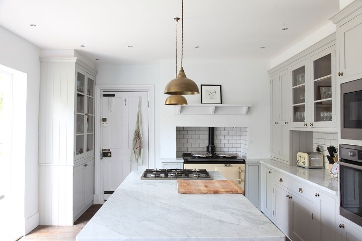 Not one but two cooktops in Steal This Look: Minimalist English Kitchen.