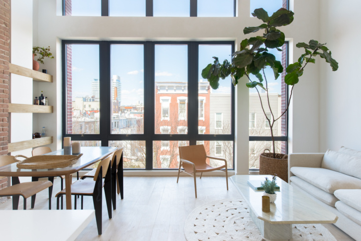 In the penthouse of a new condo development in Williamsburg, Brooklyn, Hollister and Porter furnished an airy living-dining room with Prouvé-look-alike Standard Chairs, $189, from France & Son; OX Denmarq's Rama Chair, $2,209; and just enough signs of life (the fiddle-leaf fig tree is a convincing faux—see rule Number 8).