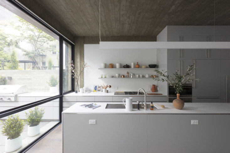 A kitchen styled with ceramics at Wythe Lane, a collection of six new single-family townhouses in Williamsburg developed by KUB and designed by the firm's in-house team in collaboration with SZ Projects.
