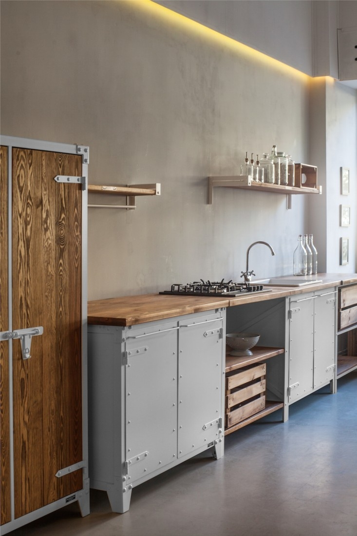 In a kitchen by a Cologne-based company, a countertop range keeps the appliance impact to a minimum and frees up storage space underneath. For more, see Kitchen of the Week: The New Old-World Kitchen from Noodles, Noodles & Noodles Corp.