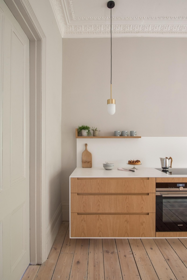 A slim cooktop and under-counter oven keeps counters streamlined in Kitchen of the Week: A Minimalist Galley Kitchen in a Georgian London Townhouse.